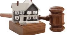 Dibujo de una casa y un mazo de jueza