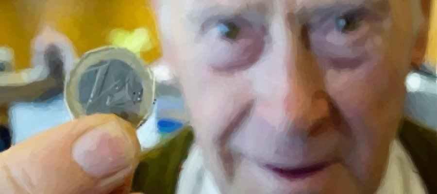 Pensioner holding 1 euro